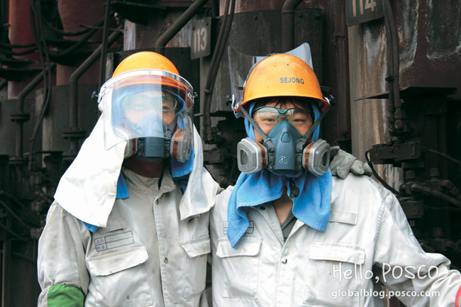 POSCO Family 'Sejongro' employees pose at Pohang 3rd Cokes Factory in heatproof gears and masks