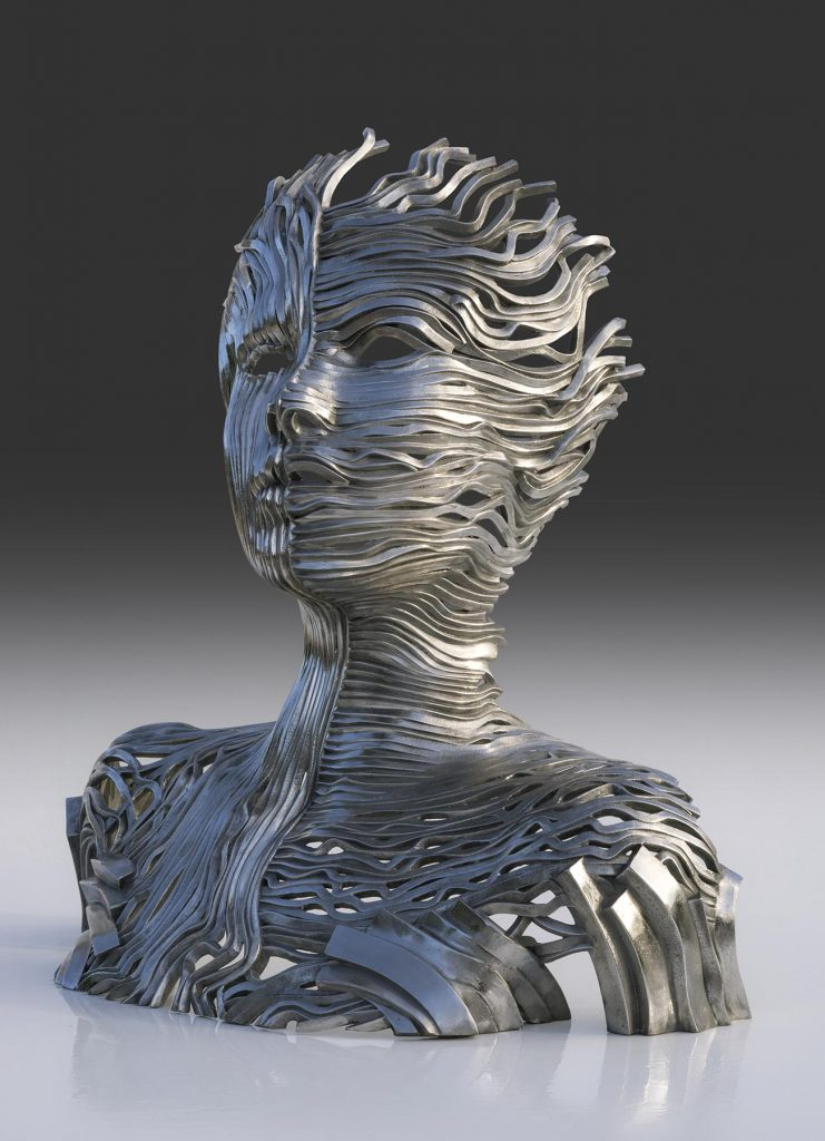 Gil Bruvel's Dichotomy sculpture uses ribbons of energy to show two sides of the human form.