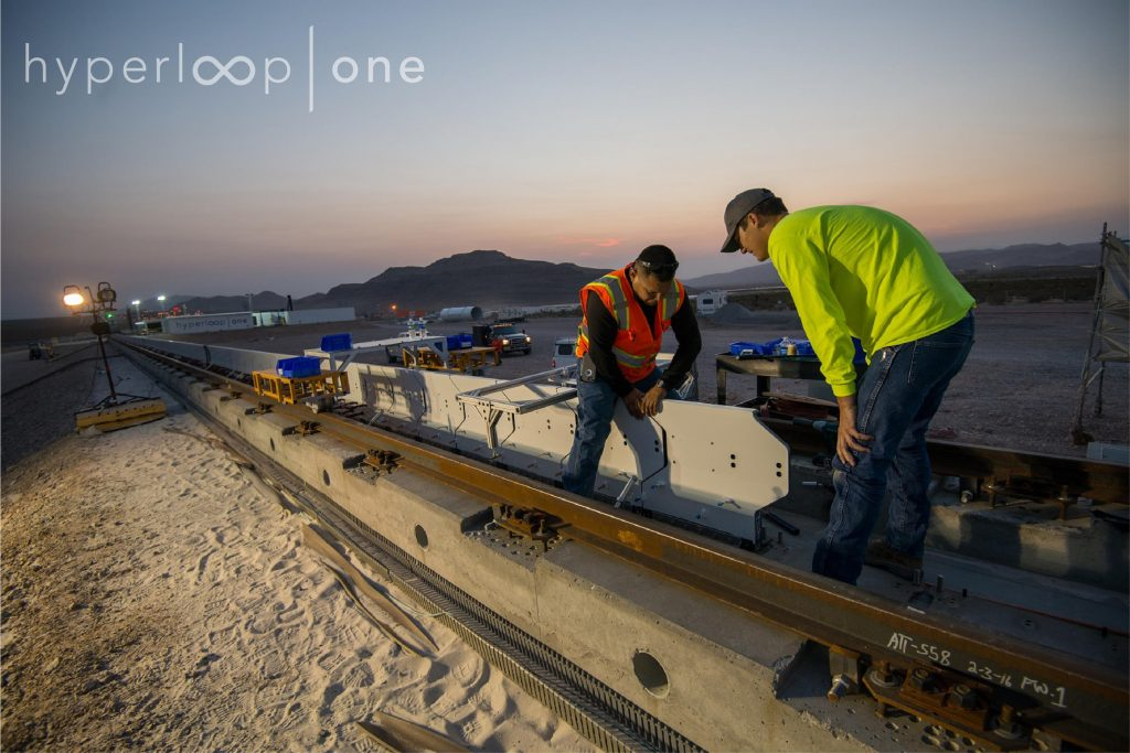 Workers install Hyperloop's stator blocks at our test and development site in North Las Vegas