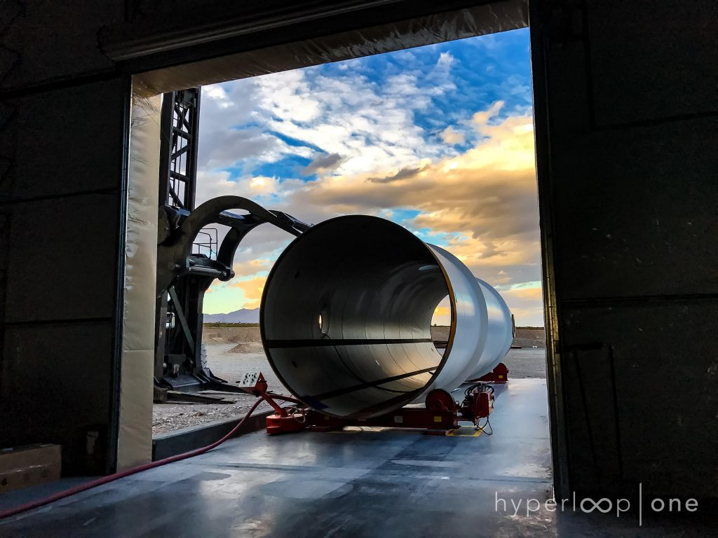 A Hyperloop steel tube awaits entry into the tube processing building, where they are painted and prepped for use.