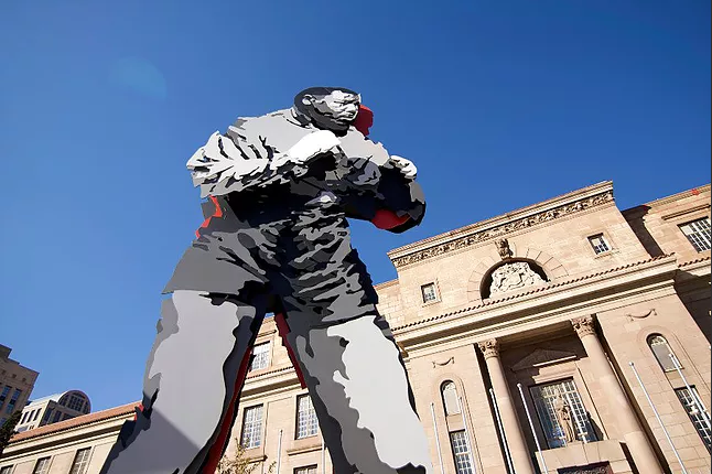 The statue of a young Nelson Mandela as a boxer stands in Johannesburg