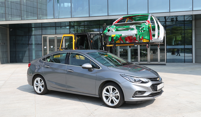 A gray 2017 All New Chevy Cruze parked outside the POSCO Global R&D Center in Incheon