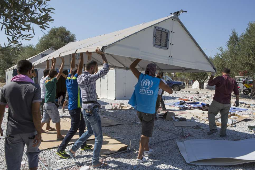 UNHCR workers and volunteers set up an IKEA Better Shelter