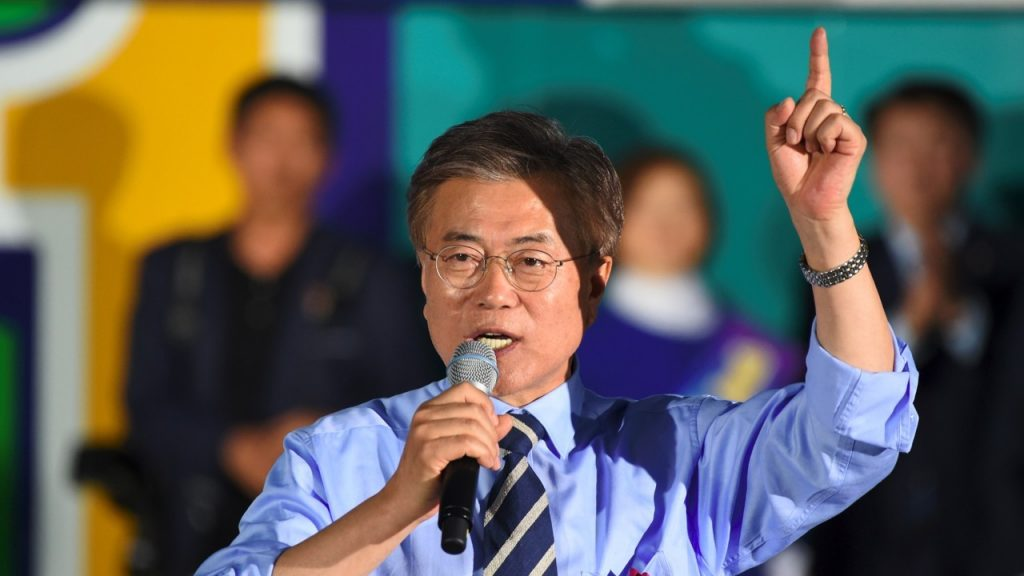Korean President Moon Jae-in talks to a crowd of people in Korea