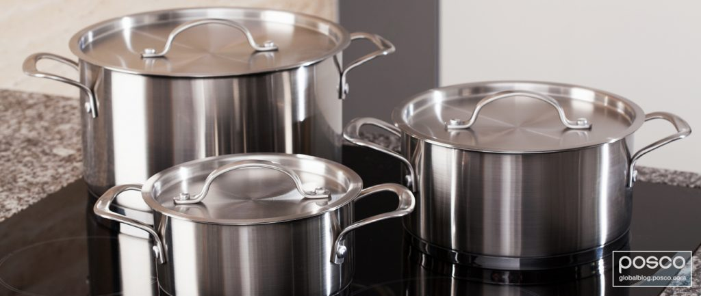 Three stainless steel pots on a stove top