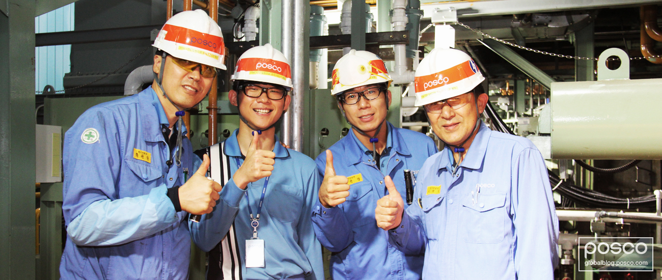 Suh Gwang-Il on site at POSCO's steel mill with his colleagues