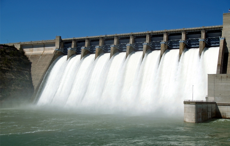 Water pours out of a hydroelectric dam.