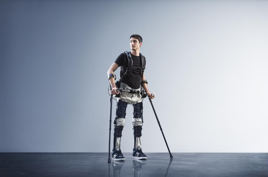A man walks with the help of the the Phoenix exoskeleton developed by SuitX