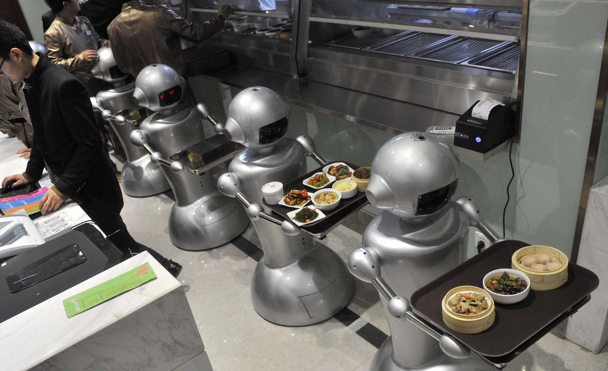Robots deliver trays of food at a restaurant, what workplaces will look like in the fourth industrial revolution.