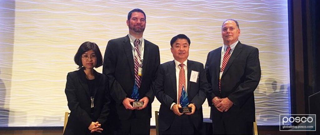 Representatives from POSCO and ExxonMobil hold their Deals of Distinction awards.