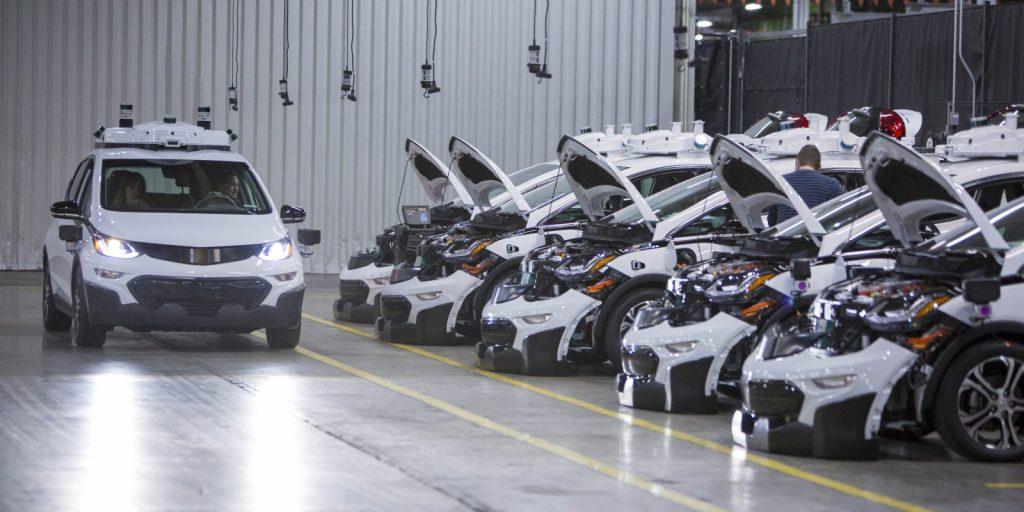 A fleet of GM Chevy Bolt EVs under inspection.