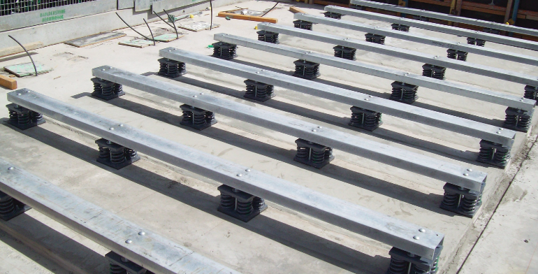 Base isolators are laid out for the base of a building.