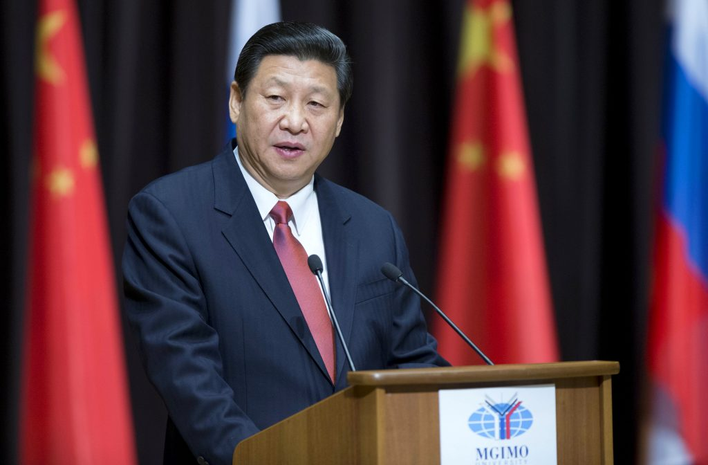 Chinese President Xi Jinping speaking at a podium.