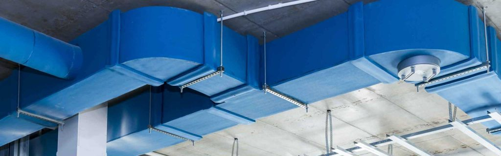 Blue boards cover the inside of a steel building.