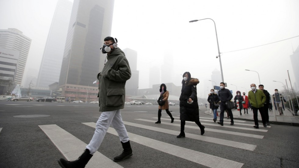 People in China crossing the street wearing masks because of smog.
