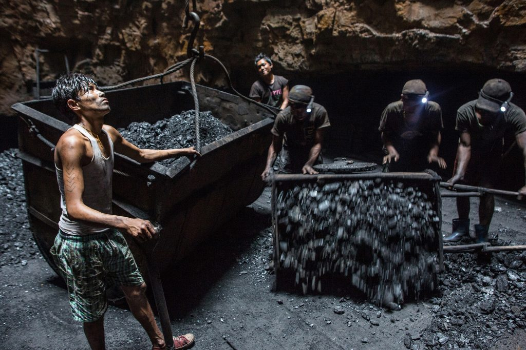 Five men working in an Indian mine.