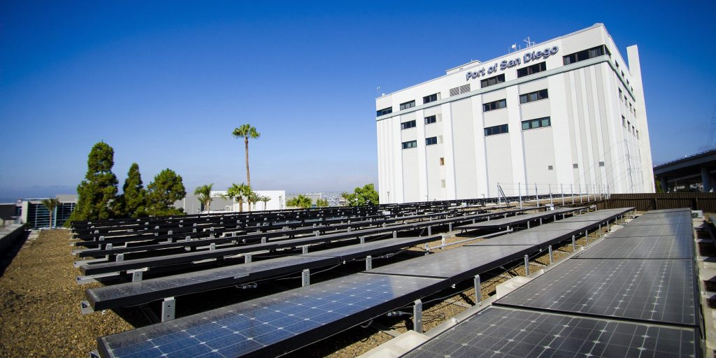 Solar panels behind the facilities of the global shipping Port of San Diego.