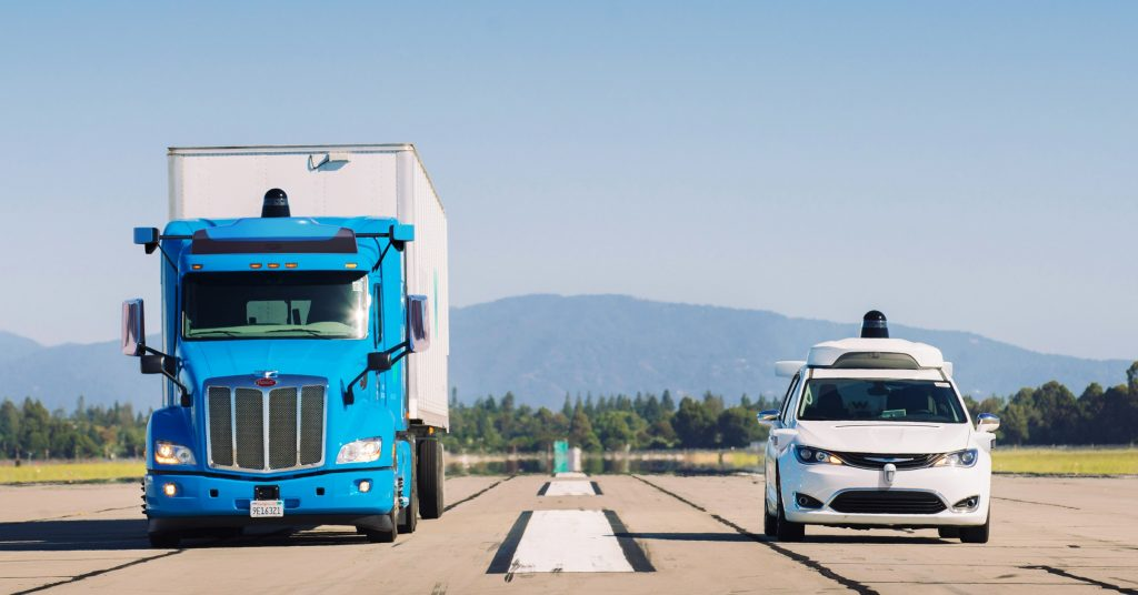 Waymo's autonomous truck being tested alongside a white van.